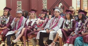 Navajo Times | Paul Natobabah Ramah High seniors listen to speakers during their high school graduation ceremony last Thursday, May 16, in Ramah, N.M.