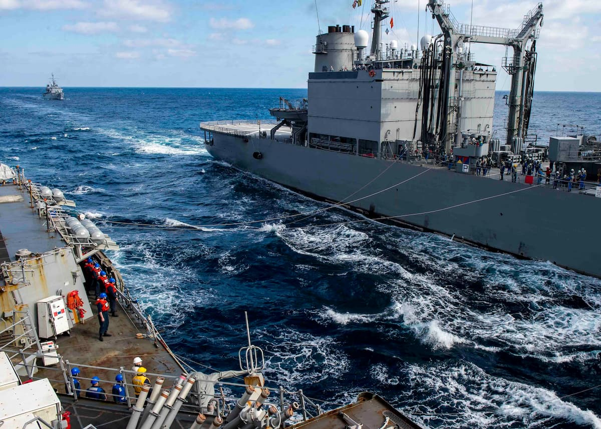 The Arleigh Burke-class guided-missile destroyer USS Curtis Wilbur (DDG 54) conducts a replenishment-at-sea with the Japan Maritime Self-Defense Force Towada-class replenishment ship JS Hamana (AOE 424)