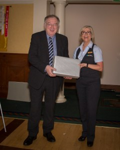Noel O'Hanrahan receiving First Place speech prize from Sharon Carolan representing Sponsors Credit Union Plus Navan.