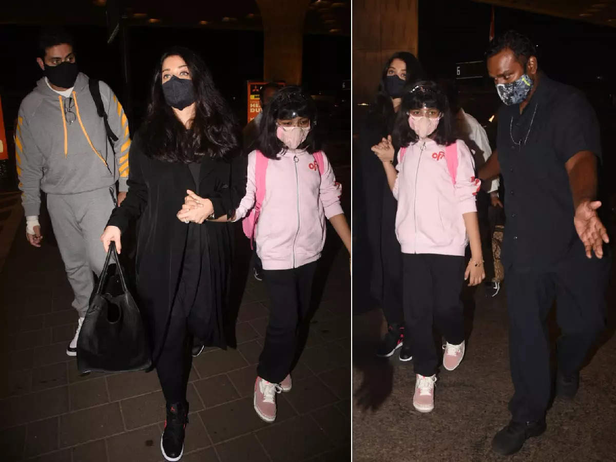 Bodyguards spot Aaradhya Bachchan rescuing her from the crowd at the airport, black from head to toe