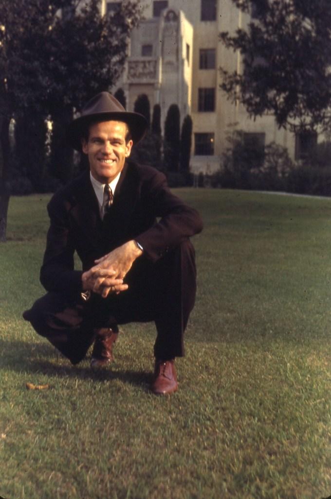 Dawson Trotman Kneeling in Suit and Hat