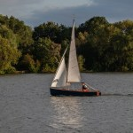 man on small boat sailing