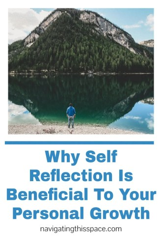 person viewing their reflection in a lake