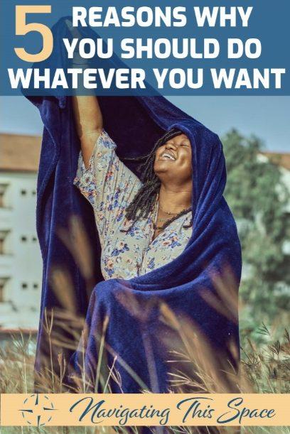 Woman raises her arm holding a royal blue fleece