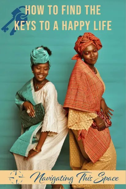 Two African women in their traditional dress wearing turbans smiling