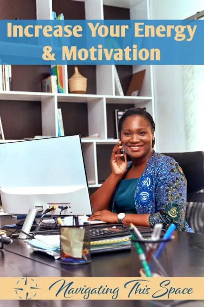 Black woman sits in her office in front of a screen motivated and increased energy