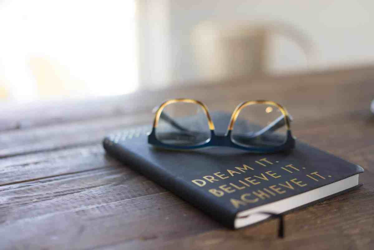 Dream it, Believe it, Achieve it journal notebook with a reading glasses