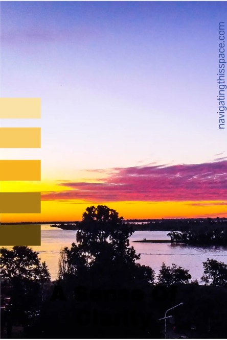 a yellow and dark purple sunset with dark trees in the foreground and a hint of orange sky representing the sense of clarity