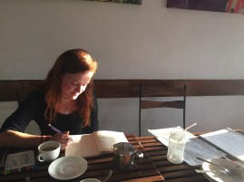 Anna journaling in a Dharamsala cafe