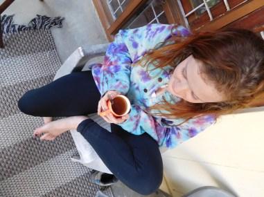 Anna drinking our homemade tea on our porch (how do you homemake tea you ask?)