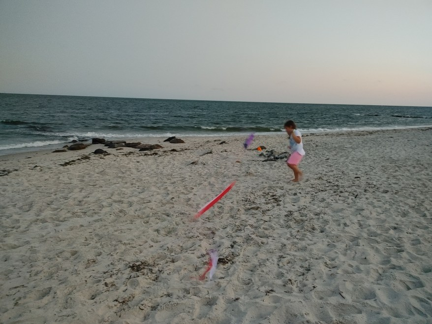 flying a kite on the beach in Cape Cod with kids