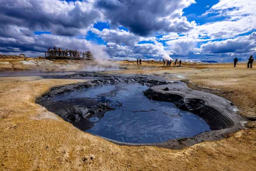 group of people gather near hot spring, hot springs for families in the USA