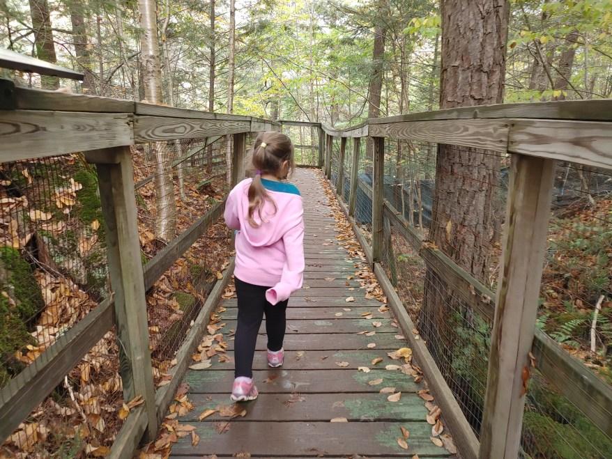 hiking with kids along a bridge