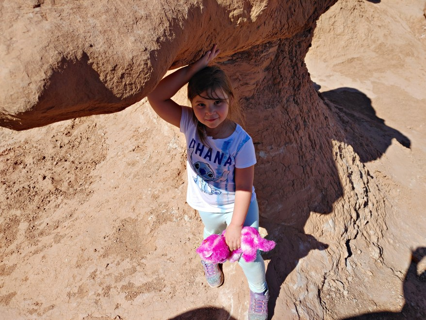 climbing among the pillars in Goblin Valley State Park with kids