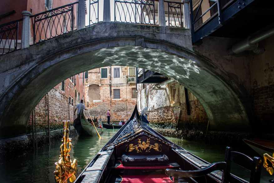 flat bottom boat on water, family friendly cities in Italy