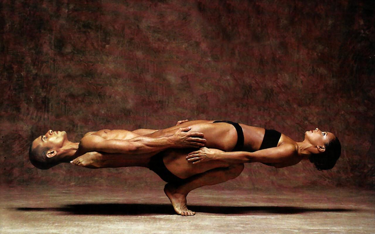 Balanced bodies in acro yoga move