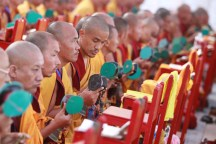 Buddhist monks perform ritual prayers during the consecration ceremony of the Boudha Stupa in the capital 18 November 2016. The stupa, which has sustained damage to its upper portion in the earthquake in 2015, will formally re-open on 22 November after reconstruction is completed. PHOTO/SANJOG MANANDHAR