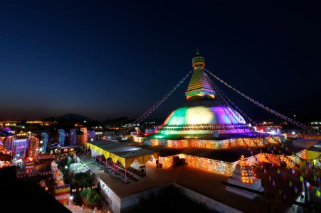 Boudhanath Stupa glows as colorful electric lights are lit during the ritual prayers during the consecration ceremony of the Boudha Stupa in the capital 18 November 2016. The stupa, which has sustained damage to its upper portion in the earthquake in 2015, will formally re-open on 22 November after reconstruction is completed. PHOTO/SANJOG MANANDHAR