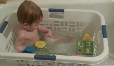 Parenting tip - laundry basket during bath time