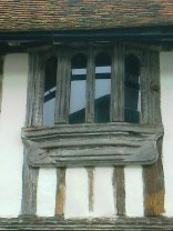Very old wooden mullions with modern glazing
