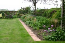 The Long Border- looking a bit like a wirless station with all the canes and string!