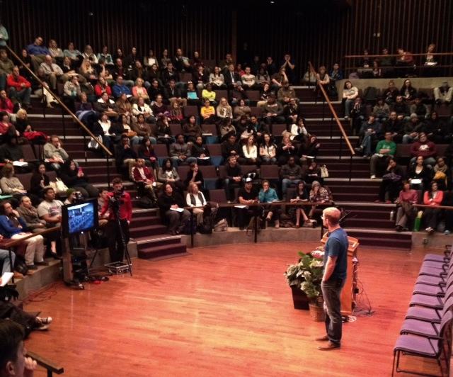 Kelsey Timmerman, author and world-traveler, speaks to the crowd at Lipkin Theatre on Thursday, March 27