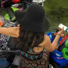 JUNE 28, 2019. CARLSBAD, CA. TGIF Concerts in the Parks mom does double duty tending to her baby and pouring a glass of rose wine at the same time. It's the spirit of the family friendly music festival at Stagecoach Park. (Photograph by Don Bartletti)