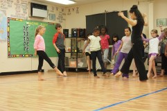 Jessi Knight Walker teaching 4th-5th graders at Morehead Elementary School.