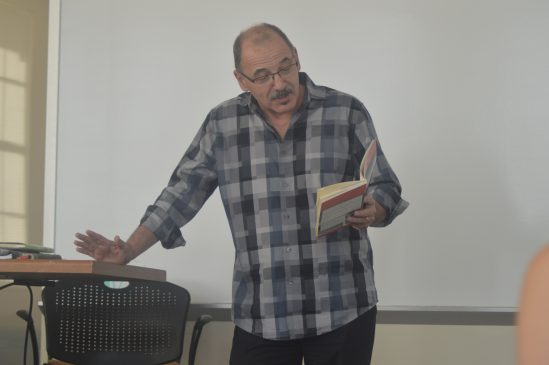 At the event, Donald Morrill read some of his works while addressing the theme of place to a captive audience of student writers.
