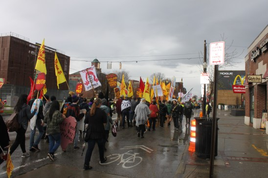 Activists walked three miles through downtown Columbus, convening at the Wendy's across from the OSU campus.
