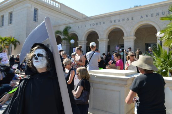 Protestors showed up in funeral attire, or in one case, the grim reaper.