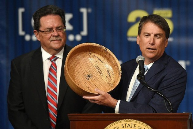 North Carolina Governor, Pat McCrory presents a bowl to CSX President and CEO, Michael Ward during a press conference on the campus of North Carolina Wesleyan College where officials announced that a deal has been reached between CSX and North Carolina to locate the Carolina Connector Intermodal Terminal in Rocky Mount. Brad Coville | Times