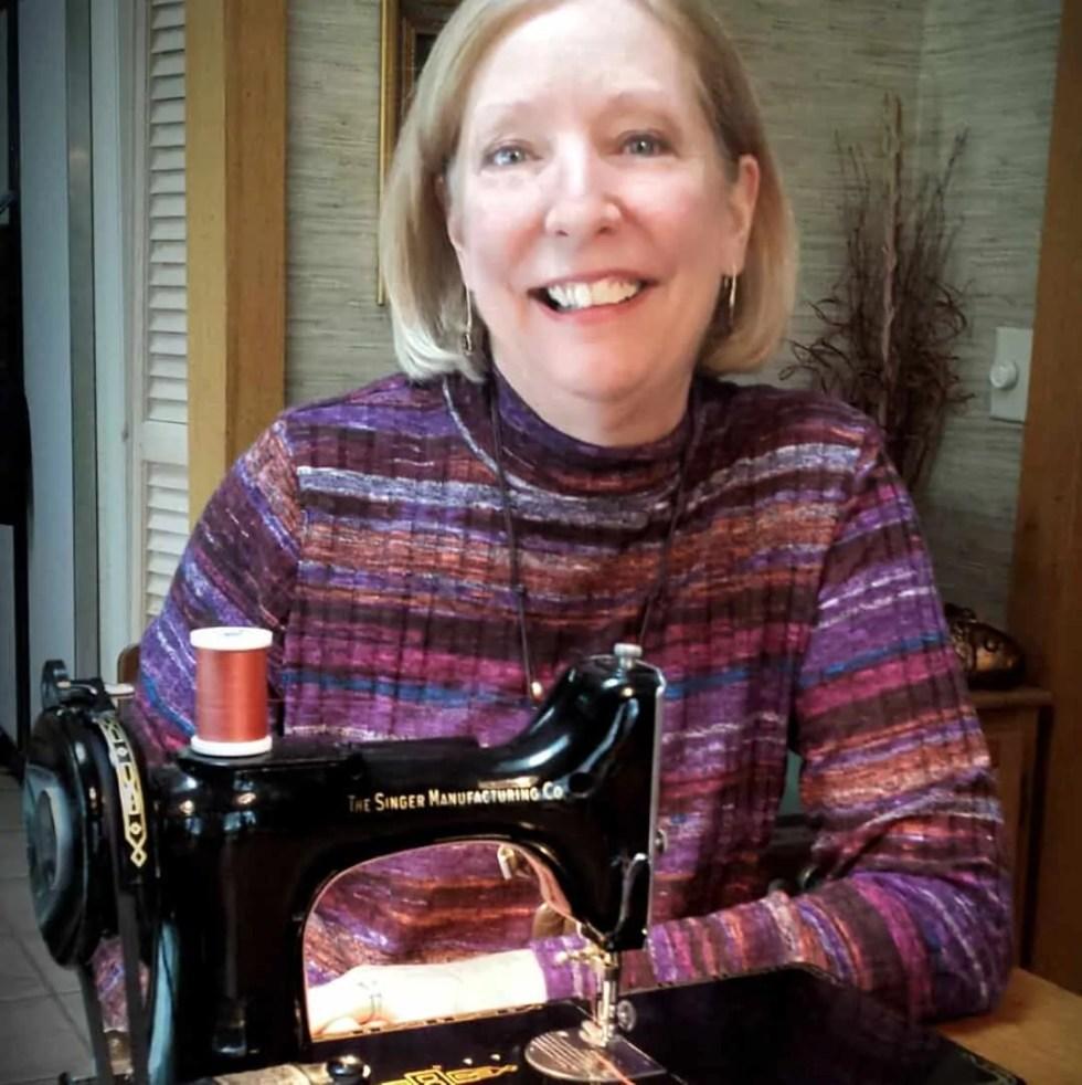 Pam Washer at sewing machine