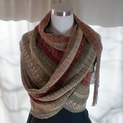 A luxurious wrap in sage, burgundy, tan, ivory and rust with golden highlights
