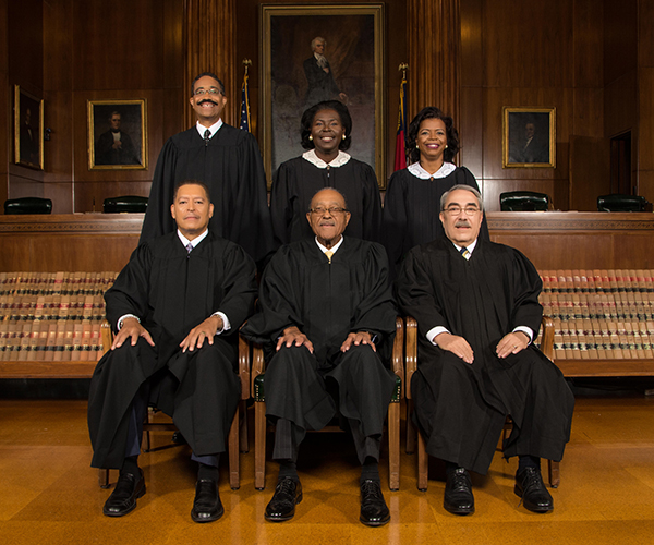 (Pictured from left to right, front row): former Justice James A. Wynn Jr., former Chief Justice Henry Frye, former Justice G.K. Butterfield.  (back row) Justice Michael Morgan, former Justice Patricia Timmons-Goodson, and Justice Cheri Beasley.