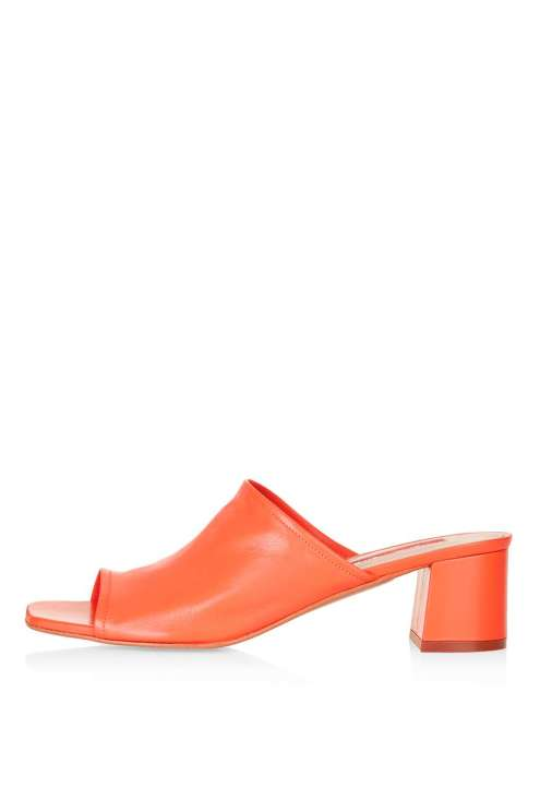 Add a pop of colour to the outfit with these sassy orange mules
