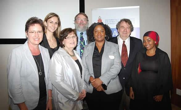 "From left to right: Marietjie Potgieter, Bianca Verlinden, Karen Kashmanian Oates, Garon Smith, Debra Meyer, David Burns, and Lungile ""Sunshine"" Sitole"