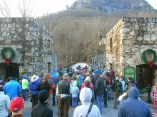 Hikers start up the entrance road at Chimney Rock State Park.