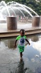 Little Boy in Green at Water Fountain Charleston SC