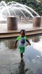 Little Boy in Green at Water Fountain Charleston SC