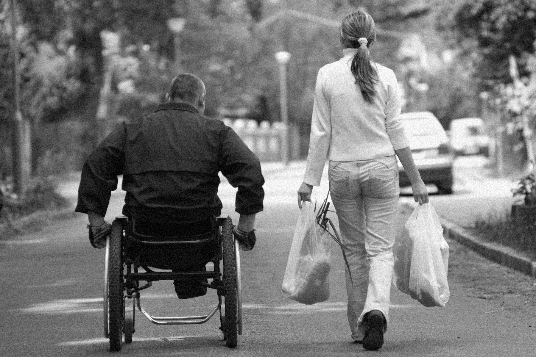 disabled-man-in-wheelchair-women-shopping1