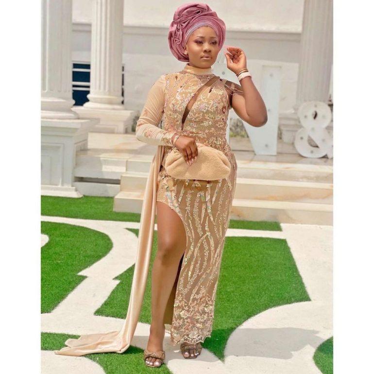 asoebi style lace dress with slit