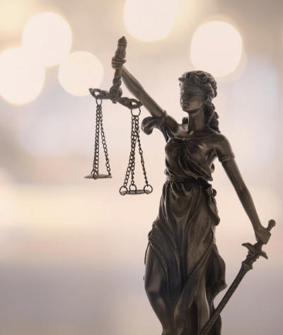 Statute of Lady Justice with weighted scales and a sword.