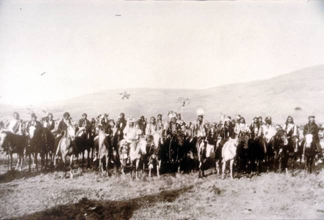 """Title Nez Perce group known as """"Chief Joseph's Band"""", Lapwai, Idaho, spring, 1877 Date 1877 Notes A large group of men on horseback with mountains in the background. In the front center of the group can be seen Chief Joseph, White Bird and Looking Glass. Subjects Nez Perce Indians--Wars, 1877 Group portraits--Idaho Lapwai (Idaho) Joseph, Nez Perce Chief, 1840-1904 Looking Glass, Nez Perce Chief, d. 1877 White Bird, Nez Perce Chief Location Depicted United States--Idaho--Lapwai Object Type Photographs Negative Number L94-7.105 Collection Roy Berk Repository Northwest Museum of Arts and Culture Restrictions http://content.lib.washington.edu/aipnw/copyrights.html Transmission Data Image/JPEG"""