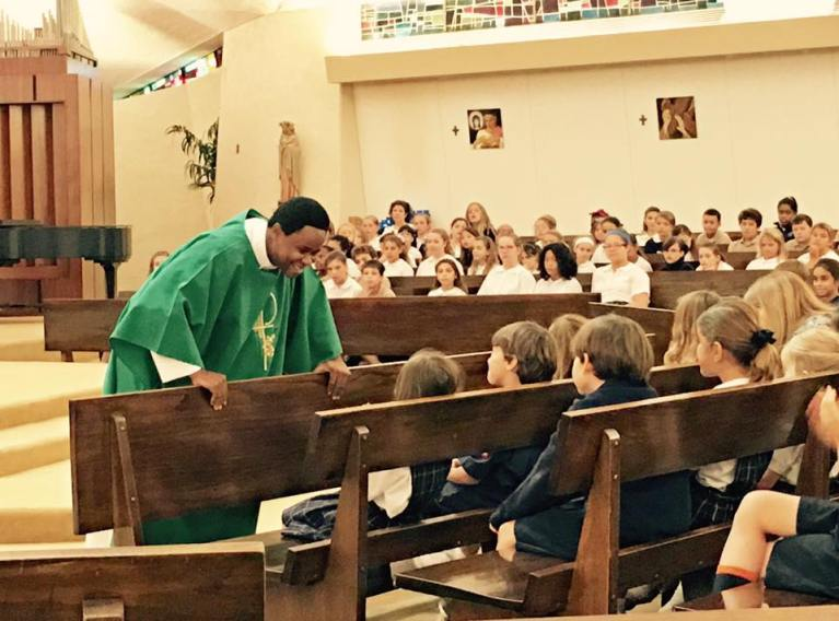 Dcn. Cletus at St. Pius School Mass 1