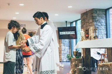 Viet Pham serving mass at Life Teen Camp Hidden Lake in Dahlonega, GA