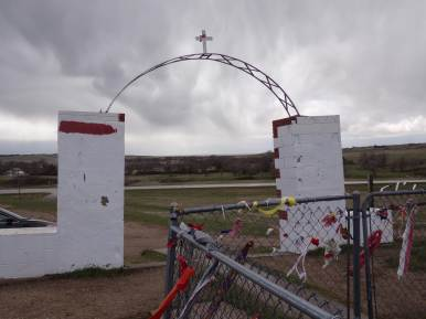 Wounded Knee, Pt. 3. Prayer ribbons are tied to a fence, sometimes with tobacco inside. Similar to our prayer candles. Native Americans make a sacrifice or offer up a prayer in commemoration.
