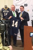 Notre Dame AD Jack Swarbrick and UA CEO Kevin Plank jointly hold up a mock-up of next year's football jersey. Let's take a look back over the jerseys worn during Coach Brian Kelly's tenure.