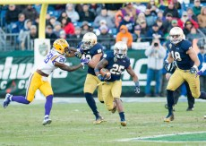Irish running back Tarean Folston runs the ball.