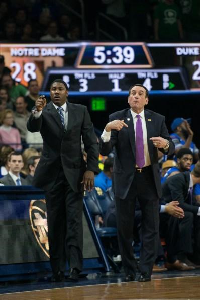 Duke coach Mike Krzyzewski (right) signals plays. Michael Yu | The Observer